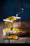 Gluten free Burger with sliced roast meat and cucumber relish, zucchini chips Stock Photography