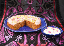 Gluten free carrot cake. With pistachios and coconut on colorful backdrop stock photo