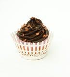 Gluten free chocolate cupcake with bronze sprinkles and wrapper. Cupcake with Chocolate top with bronze sprinkles and wrapper Royalty Free Stock Photo
