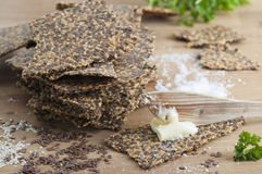 Gluten Free Crispbread. Homemade gluten free flax seed and sesame seed crispbread with butter and sea salt. All organic stock photos