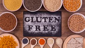 Gluten free diet options - various seeds and products, top view. Gluten free diet options - various seeds and products around black plate with text written in stock image