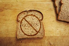 Gluten free diet. Slice of bread with Gluten text - Gluten Free diet concept Stock Images