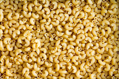 Gluten free elbow pasta. Background texture of healthy gluten free elbow pasta for use in Italian cuisine for people suffering from gluten intolerance royalty free stock photos