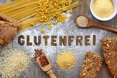Gluten free flour and cereals millet, quinoa, corn flour polenta, brown buckwheat, basmati rice and pasta with text gluten free in Stock Image