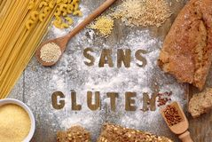 Gluten free flour and cereals millet, quinoa, corn flour polenta, brown buckwheat, basmati rice and pasta with text gluten free in. Gluten free flour and cereals Stock Photography