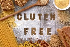 Gluten free flour and cereals millet, quinoa, corn flour polenta, brown buckwheat, basmati rice and pasta with text gluten free in Stock Photos