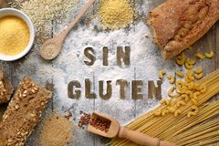Gluten free flour and cereals millet, quinoa, corn flour polenta, brown buckwheat, basmati rice and pasta with text gluten free in. Gluten free flour and cereals Royalty Free Stock Photo