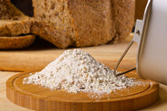 Gluten free flour with cutted fresh bred on wooden Stock Photos
