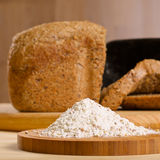 Gluten free flour with cutted fresh bred on wooden Stock Photography
