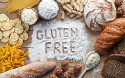 Gluten free food. Various pasta, bread, snacks and flour on wooden background from top view Royalty Free Stock Photography