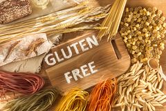 Gluten free food. Various pasta, bread and snacks on wooden background from top view stock photo