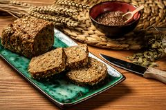 Free Gluten Free Food. Whole Grain Bread With Seeds Of Goji Berry, Pumpkin, On A Plate On A Wooden Background, Rural Food. Top View Stock Photography - 141800522
