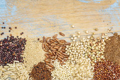 Gluten free grains background abstract. Gluten free grains (buckwheat, amaranth, brown rice, millet, sorghum, teff, red and black quinoa, kaniwa) on a grunge royalty free stock photography