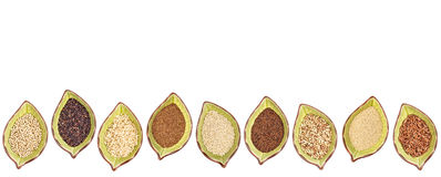 Gluten free grains - bowl set. Nine gluten free grains (millet, black quinoa, buckwheat, amaranth, teff, sorghum, kaniwa,  and brown rice) - a row of leaf shaped Stock Photography