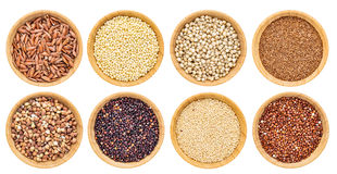 Gluten free grains collection. Buckwheat, amaranth, brown rice, millet, sorghum, teff, black and red quinoa - top view of isolated wooden bowls Stock Photo