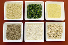 Gluten free grains food - brown rice, millet, LSA, buckwheat flakes and chickpeas and green peas legumes - aerial close-up. Stock Photography