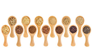 Gluten free grains and seeds  - spoon abstract. A variety of gluten free grains (buckwheat, amaranth, brown rice, millet, sorghum, teff, black, white and black Royalty Free Stock Photography