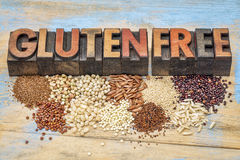 Gluten free grains and typography. A selection of gluten free grains (quinoa, rice, teff, buckwheat, sorghum,kaniwa, amaranth) and text in vintage letterpress Stock Photo