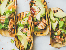Gluten-free healthy corn tortillas with grilled chicken fillet, avocado, salsa. Healthy corn tortillas with grilled chicken fillet, avocado, fresh salsa, limes royalty free stock photos