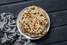 Gluten free healthy diet flatbreads on dark background Stock Photo