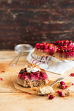 Gluten free homemade cakes with fresh cranberry, whipped cream, lemon zest and cinnamon Royalty Free Stock Image