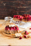 Gluten free homemade cakes with fresh cranberry, whipped cream, lemon zest and cinnamon Royalty Free Stock Images