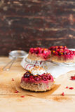 Gluten free homemade cakes with fresh cranberry, whipped cream, lemon zest and cinnamon Royalty Free Stock Photos