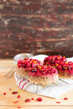 Gluten free homemade cakes with fresh cranberry, whipped cream, lemon zest and cinnamon Stock Photos