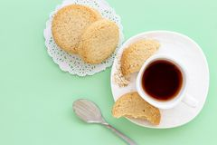 Glutenfree homemade oatmeal cookies cup of tea or coffee espresso on pastel green background. Mint color background. Top view royalty free stock images
