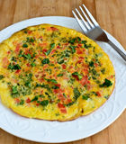 Gluten free kale omelette. Glutten free kale omelette garnished with coriander and tomatoes Stock Photo