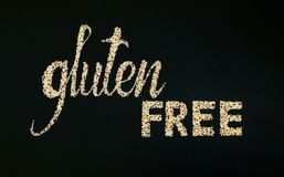 Gluten free lettering made of quinoa. Black background. Flat lay Royalty Free Stock Image
