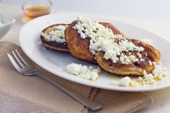 Gluten free pancakes with cottage cheese and honey. Homemade gluten free pancakes with cottage cheese and honey served on oval plate Royalty Free Stock Photos