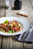 Gluten free pasta with chanterelles on herb butter, prosciutto and truffle Stock Image