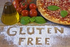Gluten free pizza on background Stock Photos