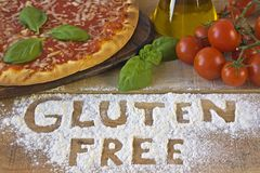 A gluten free pizza on background. A gluten free pizza on wood background royalty free stock images