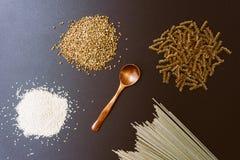 Gluten-free products: buckwheat, quinoa, einkorn polba, spelt, eincorn, emmer wheat pasta and soba buckwheat flour noodles royalty free stock photos