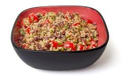 Vegetarian Quinoa Salad. Bowl of vegetarian gluten-free quinoa salad, on a white background royalty free stock photos
