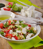 Gluten free  salad  with  feta on a wooden table. Stock Photos