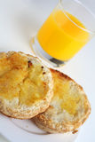 Gluten free toasted bread and orange juice Royalty Free Stock Image