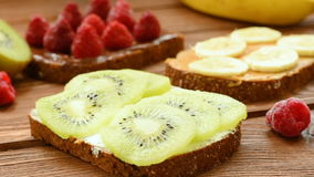 Gluten free toasts with fresh fruits and berries stock video footage