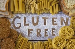 Gluten free word with wood background Royalty Free Stock Photo