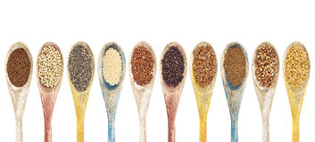 Gluten frre grains and seeds. A collection of gluten free grains and seeds on isolated wooden spoons - kaniwa, sorghum, chia, amaranth,red quinoa, black quinoa Stock Photo