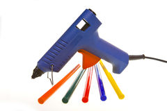 Glutinous pistol and multi-coloured glueing cores Royalty Free Stock Photo