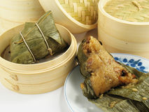 Glutinous Rice. Steamed Chinese rice dumplings (zongzi) wrapped in bamboo leaves, filled with glutinous/sticky rice, pork, mushrooms, and peanuts. These are Stock Photos