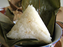 Glutinous rice. A pyramid-shaped mass of glutinous rice wrapped in leaves, special food for the Dragon Boat Festival (falling on the fifth day of the fifth lunar Stock Photography