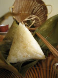 Glutinous rice. A pyramid-shaped mass of glutinous rice wrapped in leaves, special food for the Dragon Boat Festival (falling on the fifth day of the fifth lunar Royalty Free Stock Image