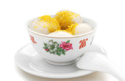 Glutinous rice balls. Chinese glutinous rice balls & chrysanthemum petal with clipping path,no logo or trademark for the bowl Stock Images