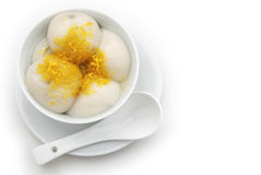 Glutinous rice balls and chrysanthemum petal. Chinese glutinous rice balls and chrysanthemum petal with clipping path Stock Image