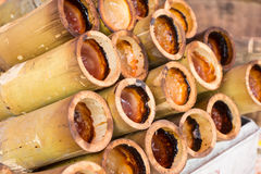 Glutinous rice in bamboo. Glutinous rice roasted in bamboo joints stock photo