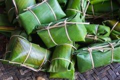 Glutinous rice with banana and banana leaf, Khao Tom Mud. Glutinous rice with ripe banana and banana leaf, Khao Tom Mud Royalty Free Stock Photography